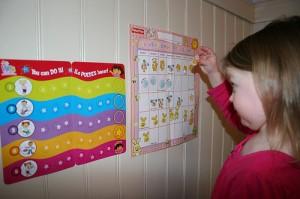 Girl Using Sticker Reward Chart
