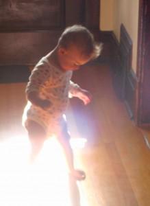 baby walking on a sunbeam