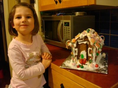 little girl and her gingerbread house
