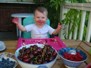 toddler with bowls of berries