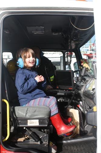 preschool girl in a fire truck