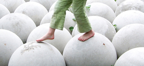 child walking on balls