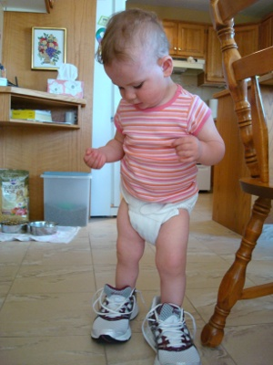 toddler wearing big shoes