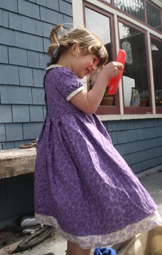 bea twirling in her purple dress