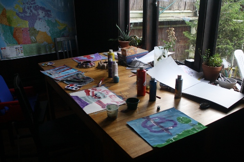 children's paintings drying on the table
