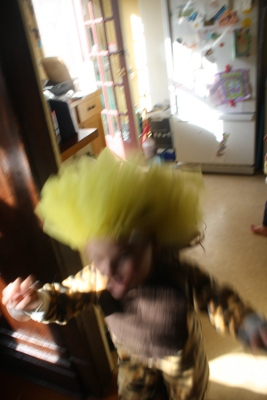 girl running in a lion costume