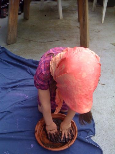 girl making mud pies