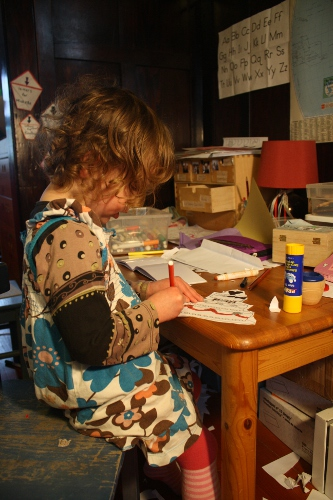 preschooler cutting and colouring