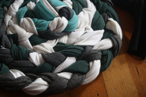 the start of a braided rag rug