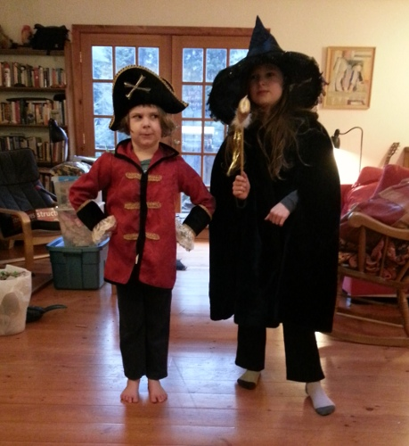 kids dressed up as a pirate and a witch